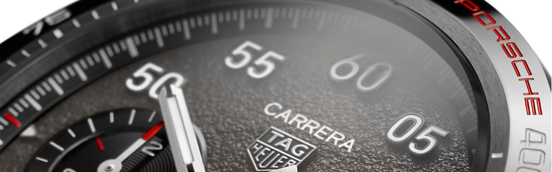 Driven by a common history that essentially involves innovation and motorsport, led by visionary families values of entrepreneurship, necessity and performance have catapulted them to the forefront of their respective industries, TAG Heuer and Porsche bring together folds in an extensive partnership that will set a new standard when it comes to brand integration...  Carrera: an iconic name that has been associated with TAG Heuer and Porsche for generations, was a natural choice as the first product of this creative collaboration. This new watch is a first indication of what the two brands can achieve together and also a tribute to the legacy of both, on and off the track.  The TAG Heuer Carrera Porsche Chronograph is an exquisite example of collaboration, cooperation, and coordination. Based on the design of the Carrera Sport, from TAG Heuer, with a characteristic tachymeter scale engraved on the bezel, it features a number of features inspired by the essence of Porsche design. This watch is a harmonious blend of the TAG Heuer and Porsche universes, reflecting the excellence of both names, without diluting the essence of either. It is a convincing union between two icons of performance, quality, and innovation.